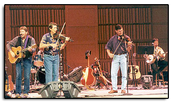 "Jim and Hereford Percy, with Pete Huttlinger help John Sommers out on ""Thank God I'm a Country Boy"" at the Riverwalk Center in Breckenridge Colorado in 1999."
