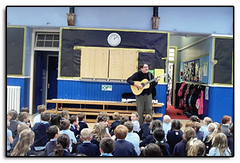 While on tour in Scotland in 2014, Jim stopped in at the Grantown Primary School to perform for the kids.