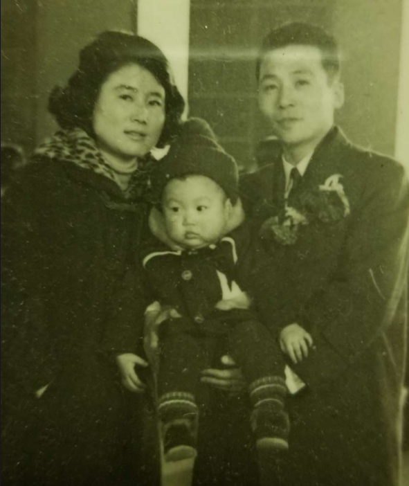 Kim Soo with his wife and son, Sean, upon arrival to the United States when he immigrated them here from South Korea in the late 1960s.