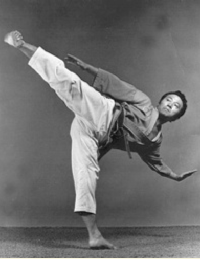 Kim Soo striking a power kick pose in 1970.