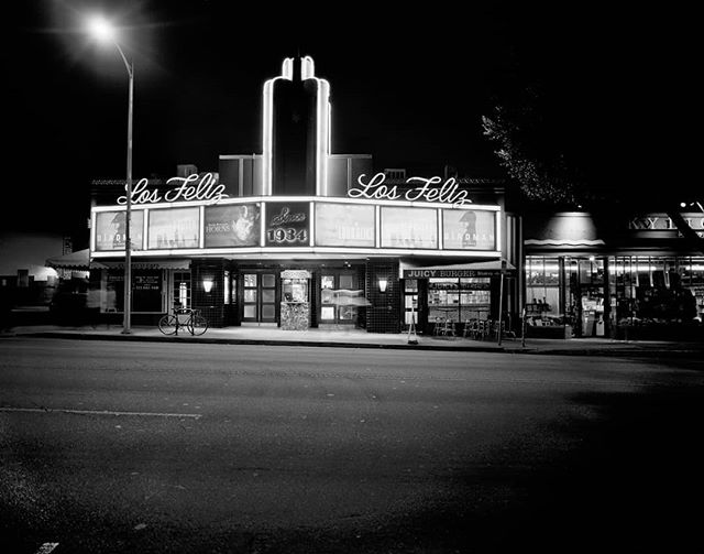 "The Los Feliz 3, Nov. 2014. A funky little theater in one of my favorite parts of LA. This shot marks the beginning of a new body of work, when I went back to shooting almost exclusively on film. I lugged my Calumet 4x5 down the street and pulled out my tripod, light meter, my little Moleskine notebook and made three separate exposures in a process best described as ""deliberate."" Some would just call it ""slow."" This shot reminded me of what I was capable at a time when I'd nearly given up on photography all together. Good things take time. . . . . . #calumet #4x5camera #largeformatcamera #4x5film #ilfordhp5 #losfeliz3 #skylightbooks #juicyburger #vermontave #franklinave #birdman #neon #artdeco #hollywood #shootfilm #beselective #filmisalive #back2thebase #longexposure #nighttimephotography #moleskine #deliberatecreator"