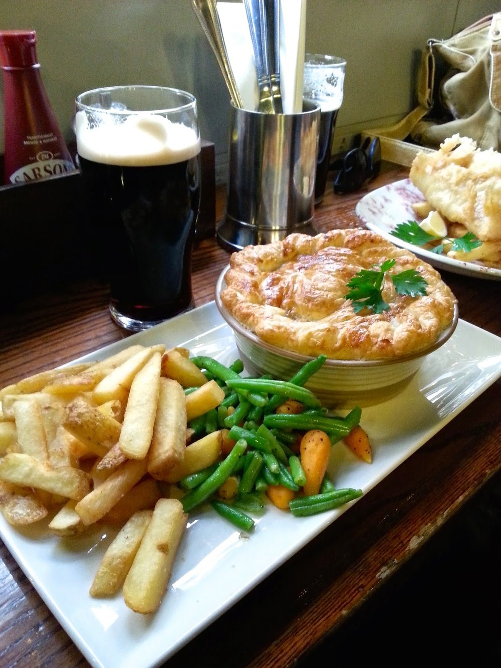 Pie and chips and a Guinness. Happy girl.