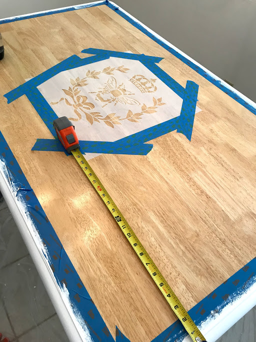 I centered my stencil with a tape measure (always a classic move) and taped it down with painters' tape.