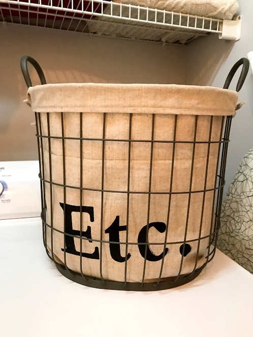I picked up this basket at Michaels for $17.99. It's perfect for holding laundry room odds and ends like my iron, a box of dryer sheets, a stain remover stick and more.
