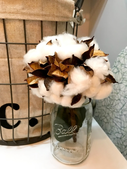 I grabbed this little stem of cotton balls for $7.79 from Michaels too and put it in a Ball jar. And a cotton bouquet feels perfect for the laundry room!