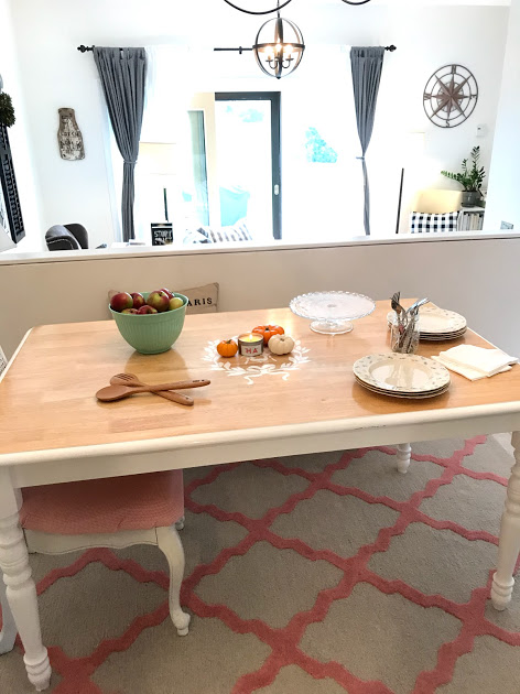 Set up before guests come. Burn the candle, make your gourd centerpiece (or other seasonal centerpiece. Put out the apples. Put out spoons for salad. Put out plates, napkins and silverware in a Ball jar. Put out a cake stand for store-bought cookies. Now go get pizza.
