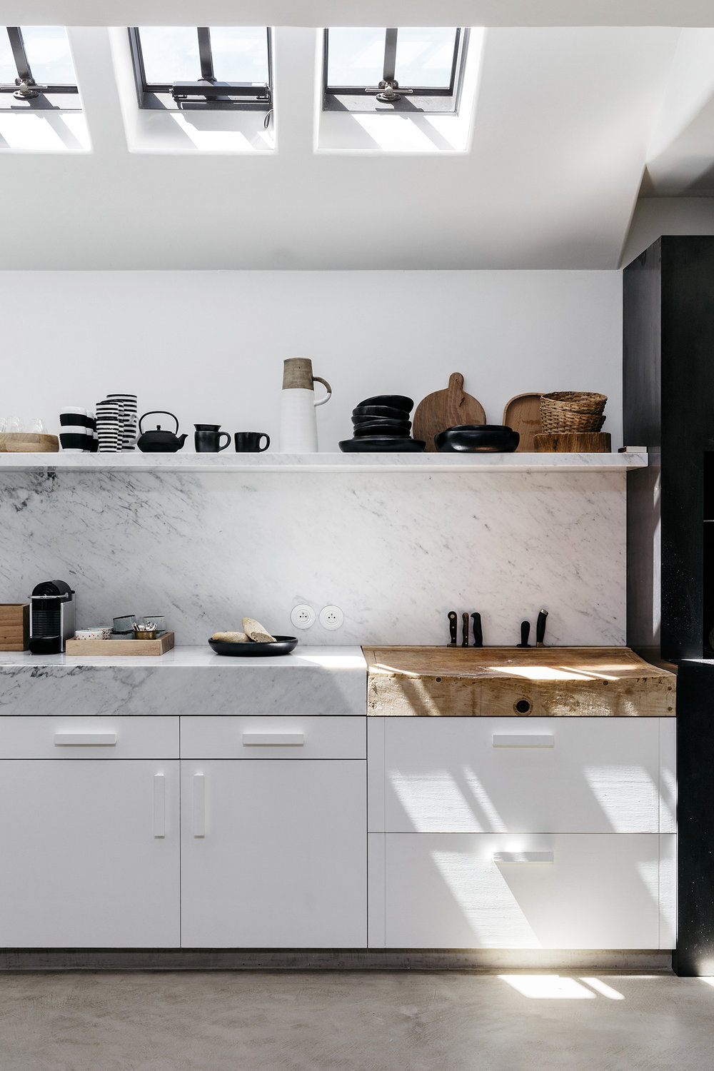kitchen-with-skylights-wood-chopping-board-thick-marble-countertop-and-clean-minimal-style-coco-kelley-scandinavian-vacation-home-tour.jpg