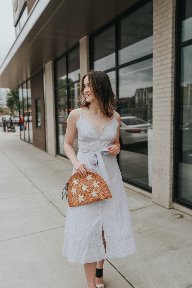 women's dress and handbag