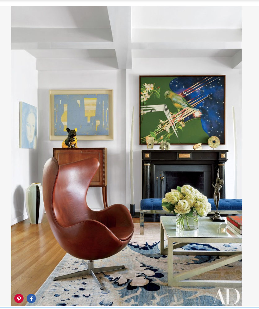 The living room walls display, from left, a Francesco Scavullo photograph of Hearst from the 1980s, a mixed-media work by Caio Fonseca, and a James Rosenquist painting; the 19th-century mantel is from  A & R Asta .