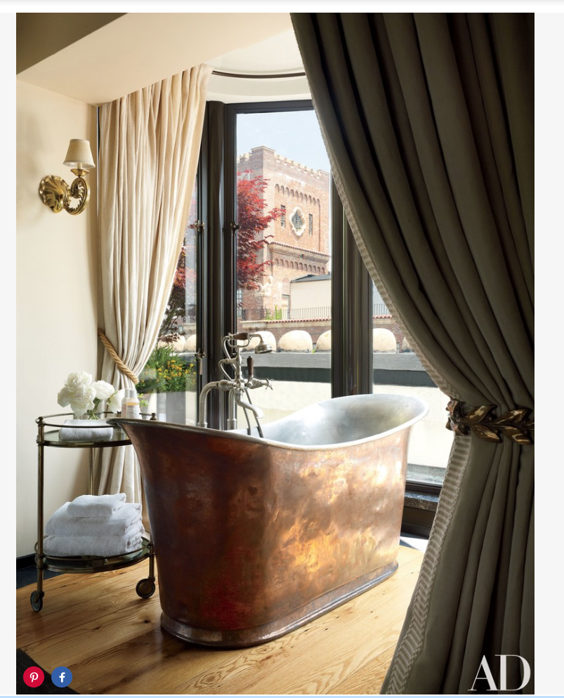 In the master bedroom, an antique copper tub with  Waterworks  fittings is accompanied by a '50s Baguès trolley.