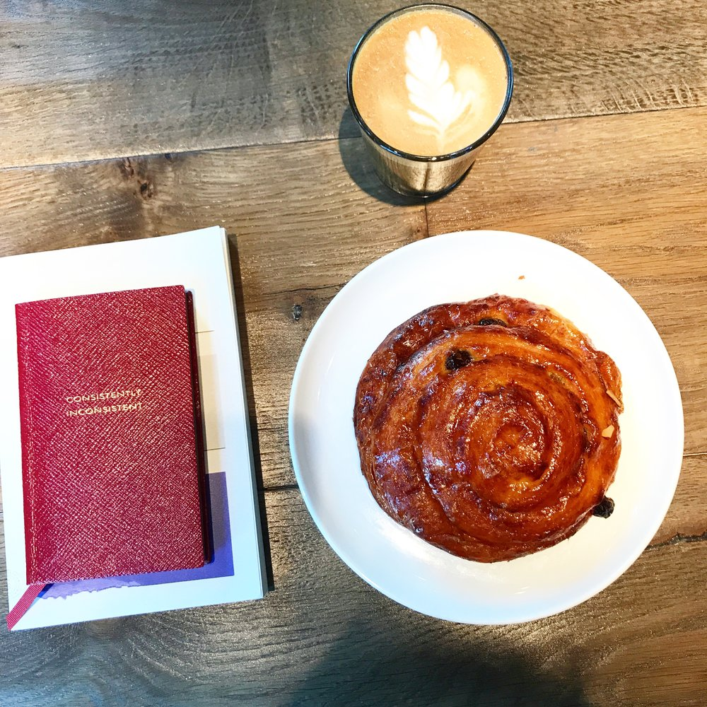 Beautiful latte, stylish book/notebook. - Does this scream