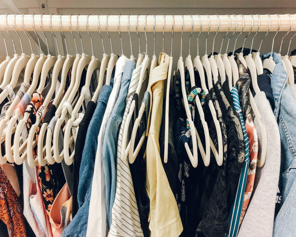 How to Simplify Your Wardrobe & Feel a Whole Lot Happier | In this post, you'll get a sneak peek at my minimalist closet. I'm also sharing my best tips for creating a sustainable wardrobe + my favorite closet organization ideas and products. | Om & The City #omandthecity #minimalism #closetorganization #simplewardrobe #sustainablefashion
