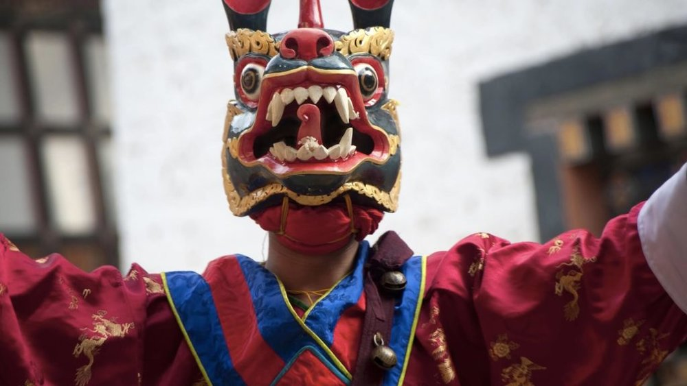 man-with-a-mask-on-at-a-festival-in-asia-1024x576.jpg