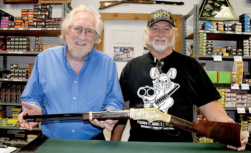 Jim Wheeler, owner of Wheeler's Guns and Ammo, accepts his custom designed Henry Golden Boy .22LR from Steve Faler[right], owner of Heroes and Patriots, LLC  Photo Credit: The Inter-Mountain by Tim MacVean
