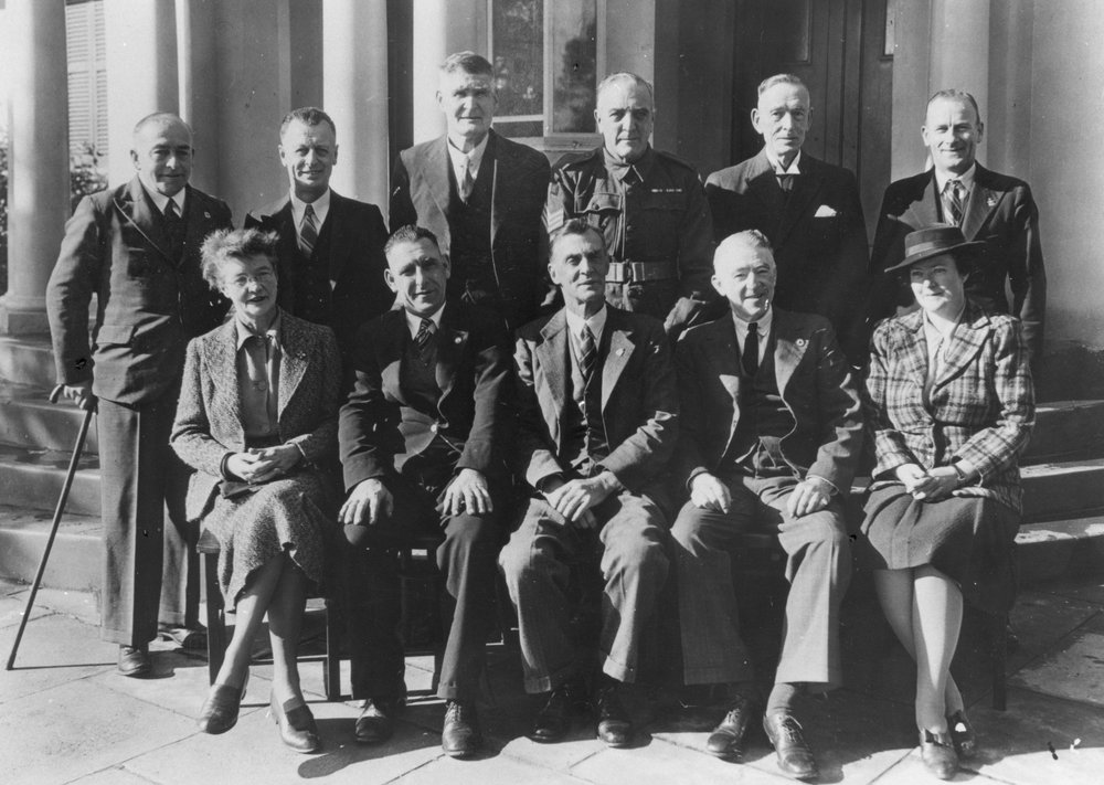 Guildford Municipal Council 1944, outside Guildford Town Hall. Guildford's history of local government stretches back to 1839, and was the first local council in WA to which two women councillors were elected at the same time. Cr Miss Helena King is on the left, Cr Dr Merab Taubman is on the right. Photo Swan City Library Local History Collections.