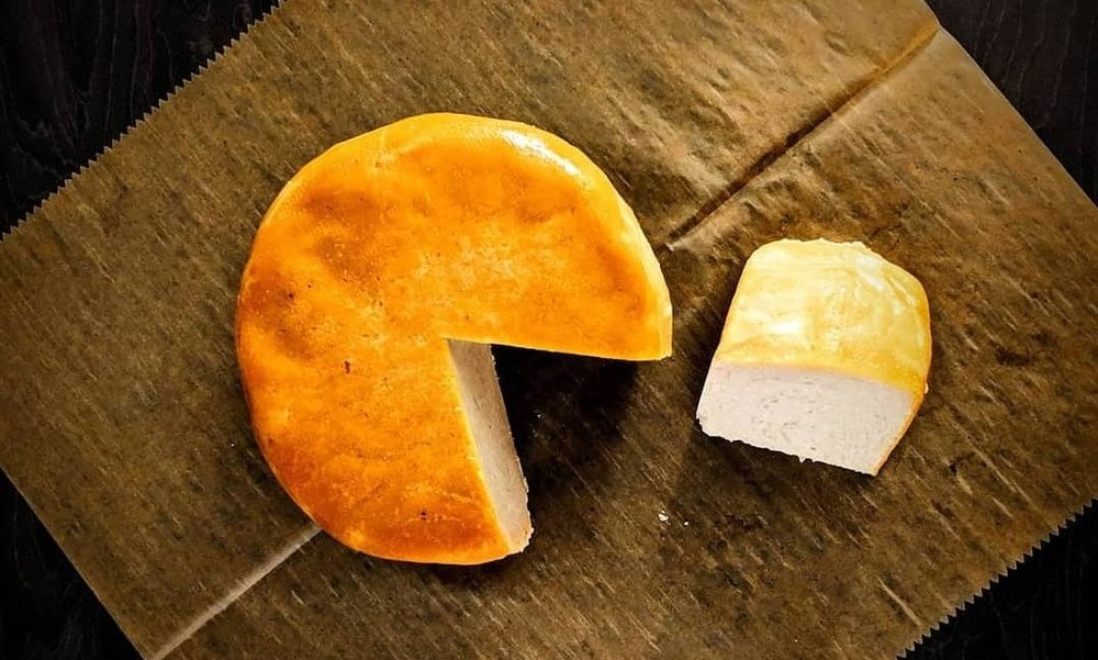 Vegan cheese with slice taken out.jpg