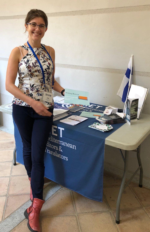 Jess Kelley presenting the Helsinki Writing Retreat flyers at METM18 in Girona, Spain.