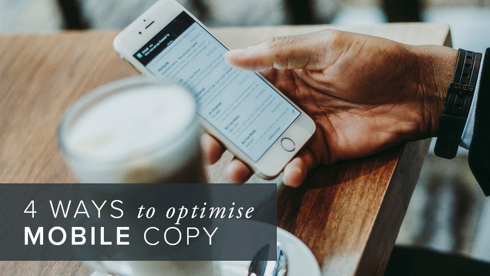 '4+ways+to+optimise+mobile+copy'+over+an+image+of+a+hand+holding+a+mobile+phone.jpg