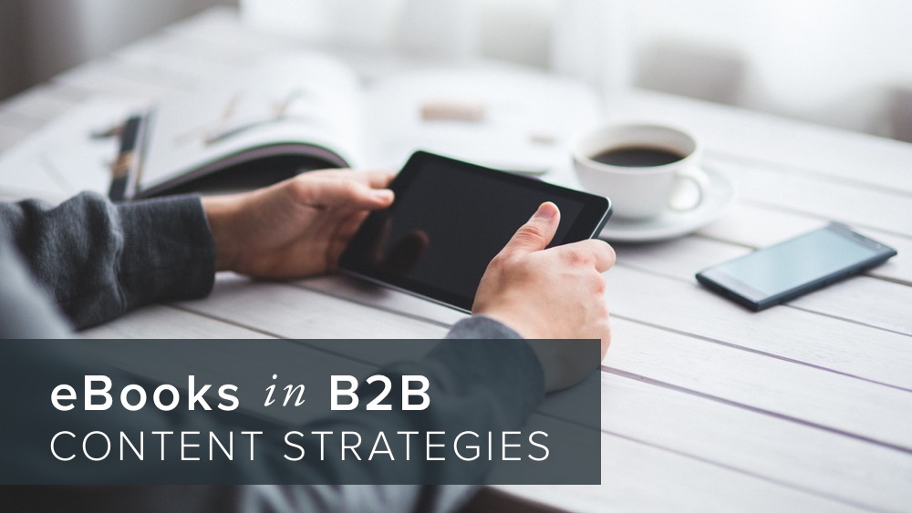 'ebooks+in+b2b+content+strategies'+over+image+of+man+holding+tablet.jpg