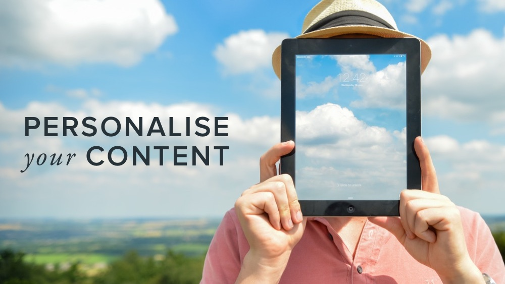 'personalise+your+content'+over+image+of+man+holding+tablet+sky.jpg