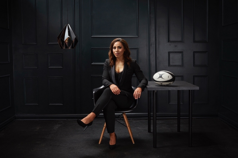 Sene Naoupu sitting in room beside rugby ball