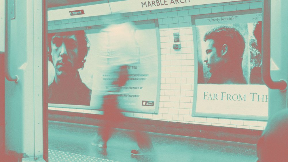 Posters at tube station in London
