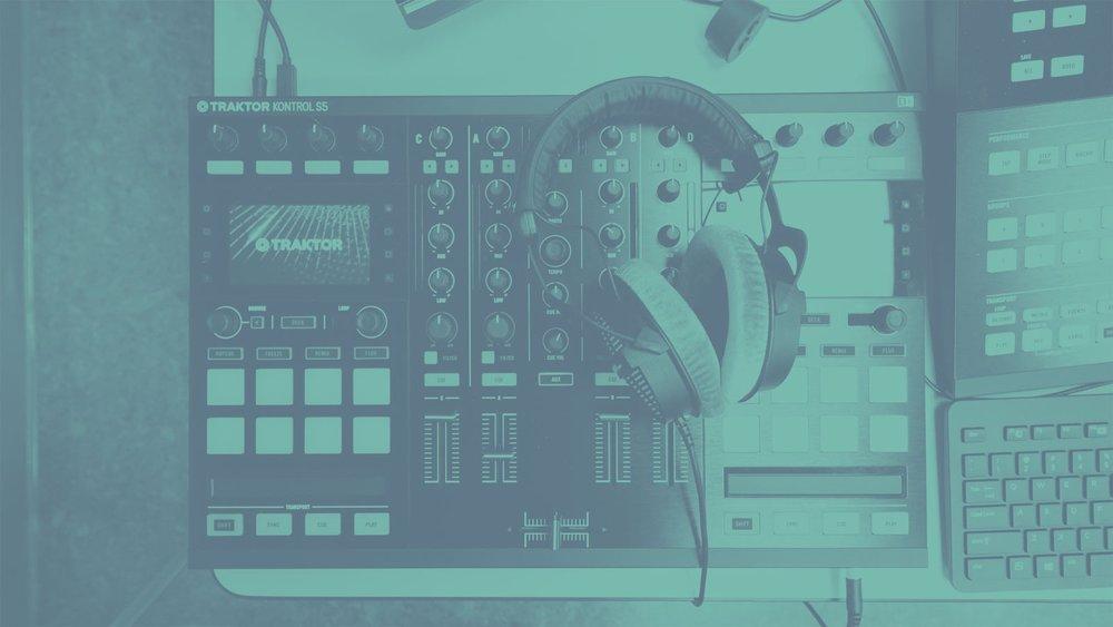 Blue filtered image of headphones slung over sound deck