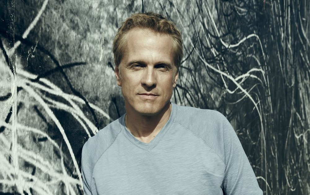 Actor Patrick Fabian leaning against a wall