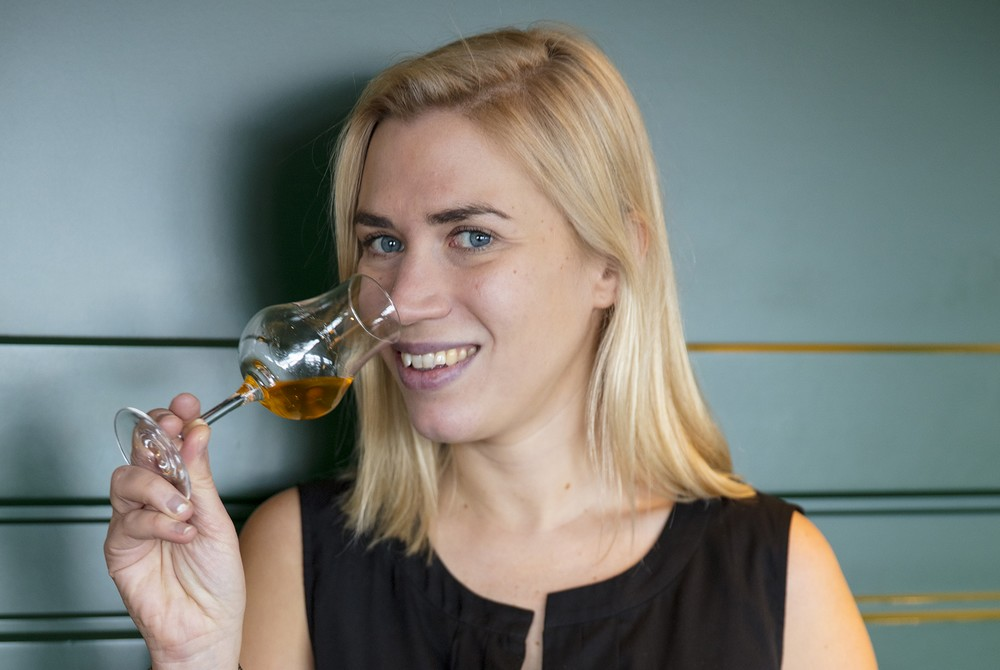 Georgie Bell holding a glass of whisky to her mouth