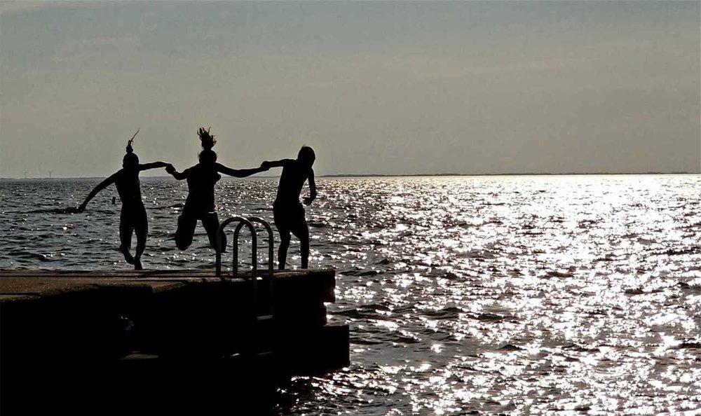 Kids off pier at sunset.jpg