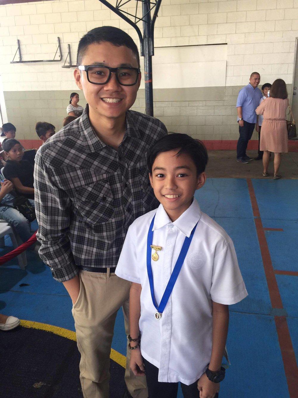 Mio and his Dad, Roman during his Grade School graduation in March 2016