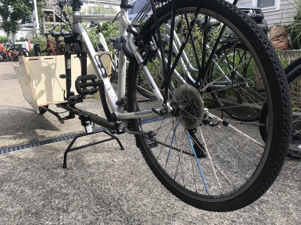 The rear tire is about 4 inches above the ground when the kickstand is engaged