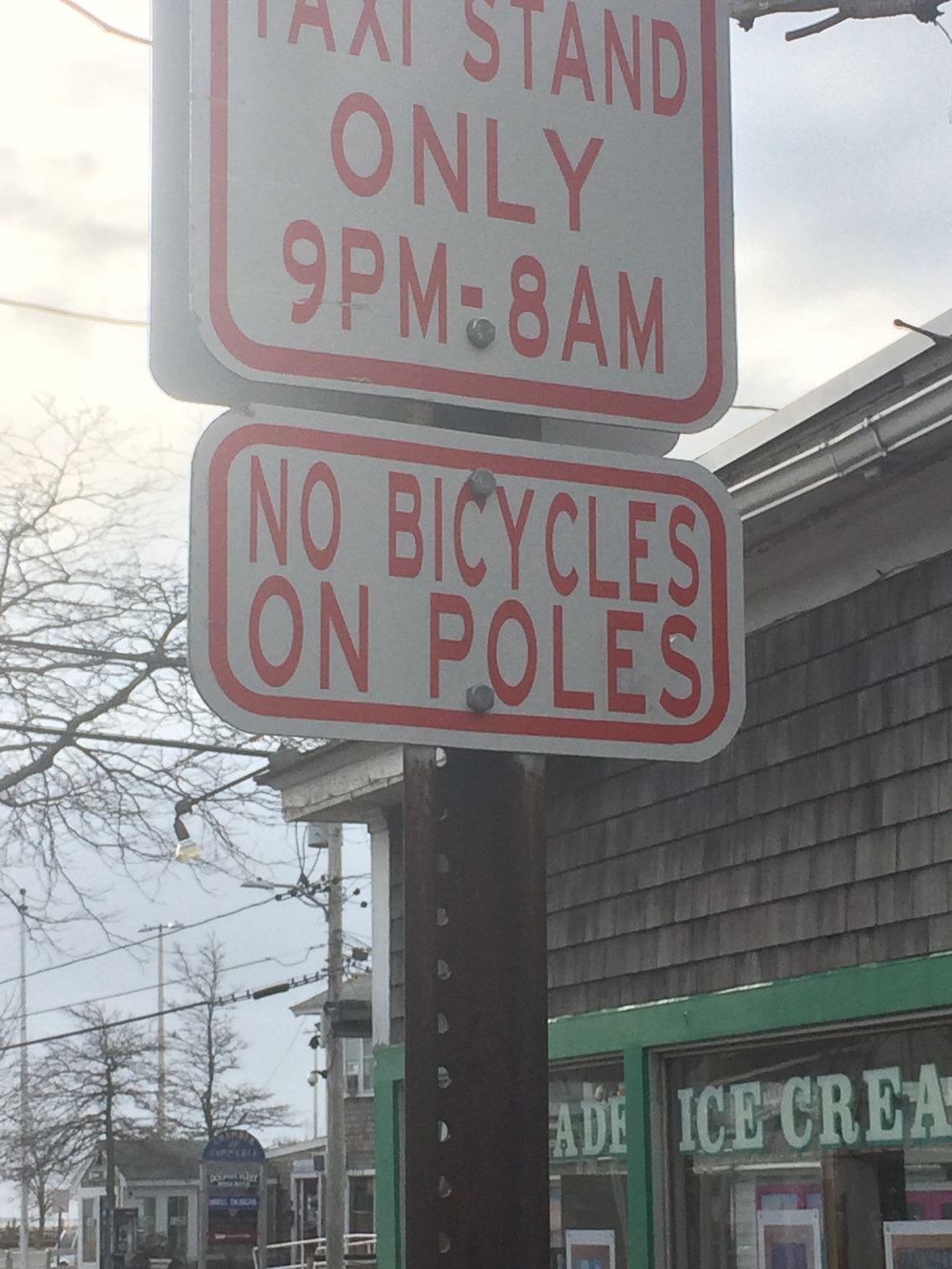 """""""No bicycles on poles"""" sign on Standish Street in Provincetown"""