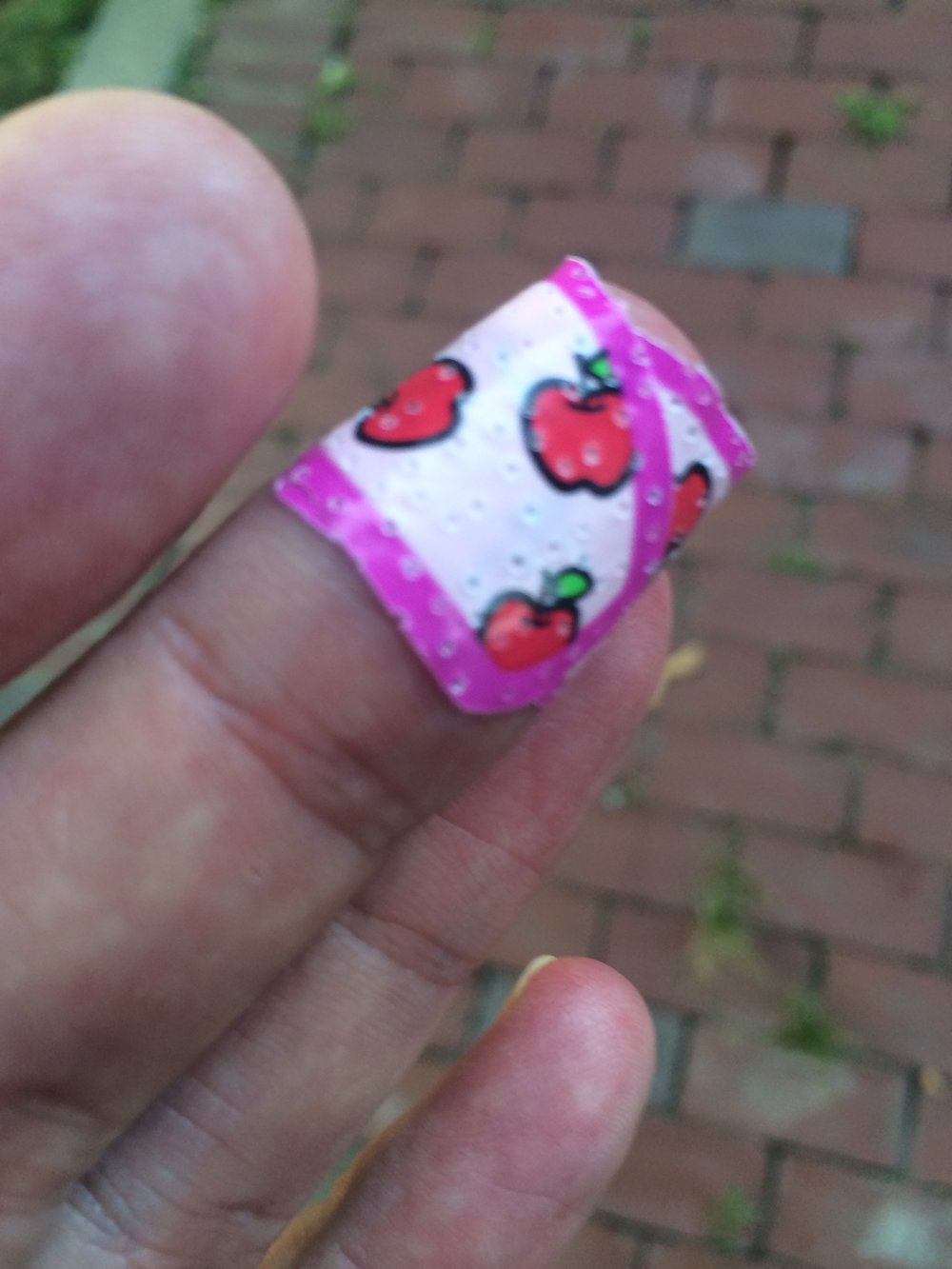 Ouch! A Hello Kitty band-aid covers a minor injury.