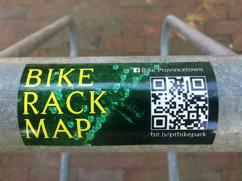 Bike racks around town now have these Provincetown bike rack map stickers that include a QR code and link to the online bike rack map.
