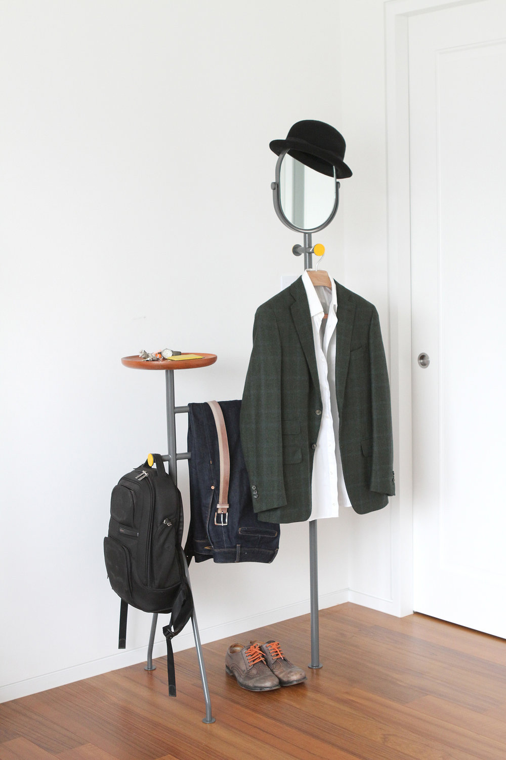 Butler  | This is a modernised valet stand using minimal amount of materials. Butler can be used front and back depending on the user's preference as there is no right side. The legs are designed to be adjustable for uneven floors.