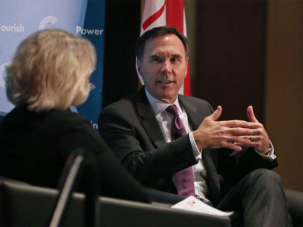 Finance Minister Bill Morneau spoke to the Calgary Chamber of Commerce on November 27, but did he pay any attention to the hundreds of people protesting on the street outside? (Photo credit: Calgary Herald)