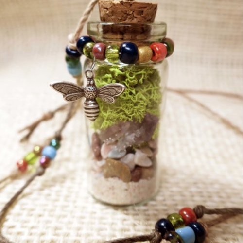 Earth Bottle Necklace - In this workshop you will be filling a small glass bottle with layers of natural elements like sand, stones, crystals and moss to create a wearable earth terrarium style necklace. You will also embellish your bottle and create the beaded cord to wear your creation home. A great way to honor Earth Day! Ages 10+All materials are included.Instructor: Christina DavisWorkshop fee: $28 per person, minimum 5, maximum 12
