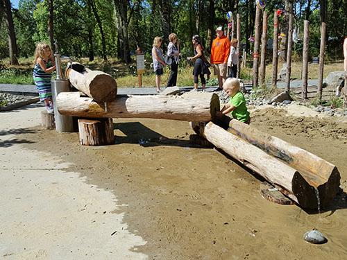 Cadron Creek Play Pump-n-Play Log Trough Playground Pump.jpg