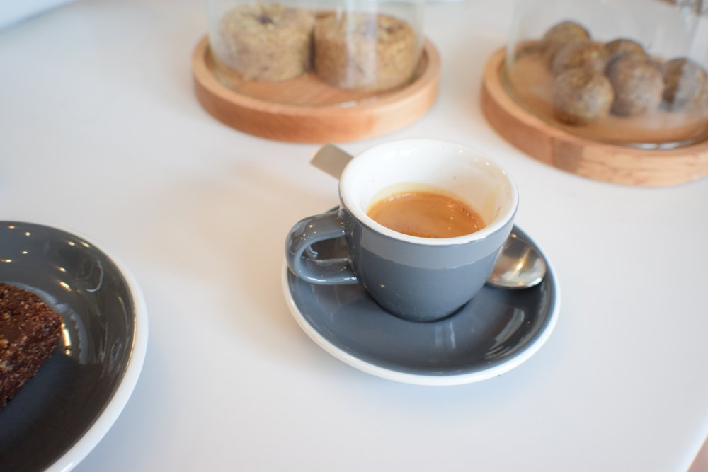 Delicious treats pair perfectly with creative espressos, like this one flavored with citrus.
