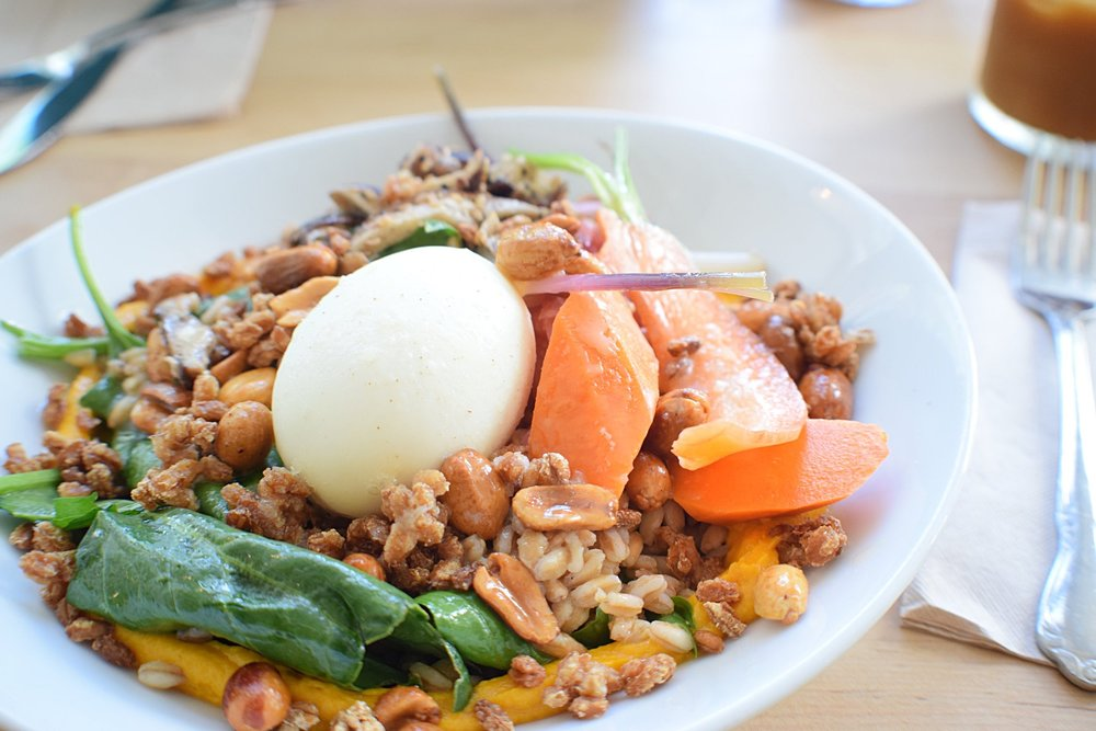 A breakfast grain bowl with jammy egg and miso carrot puree