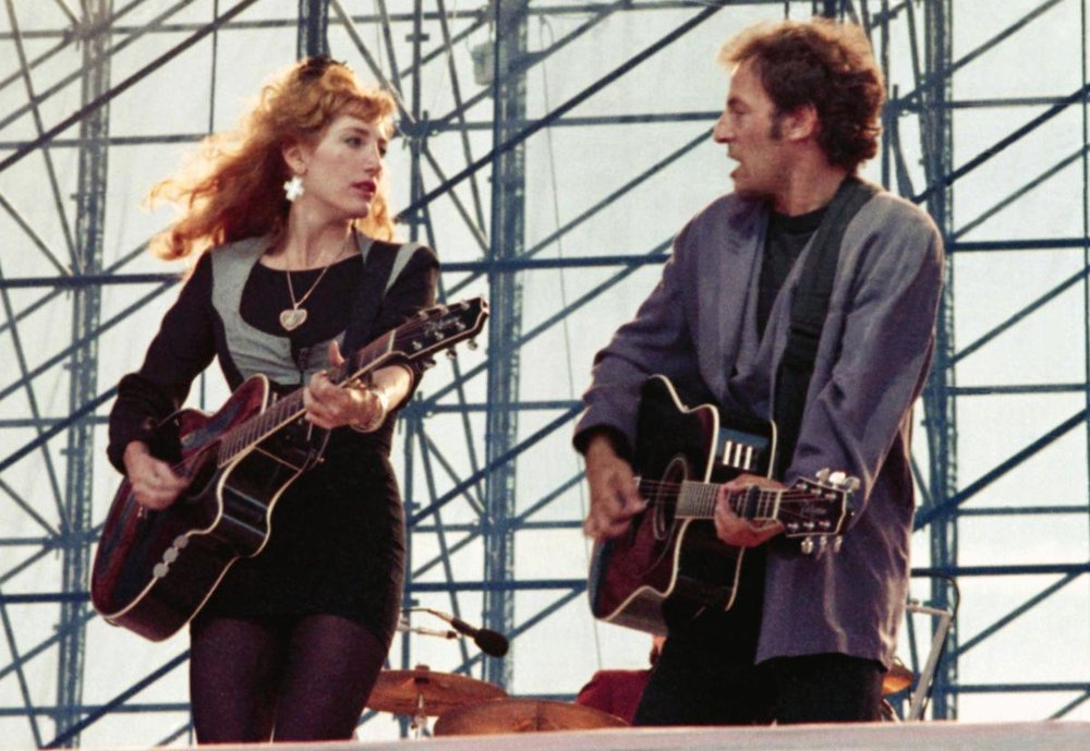 American rock star Bruce Springsteen sings with Patti Scialfa June 20,1988 on the stage during his concert in Vincennes, a suburb of Paris. They are reported to be romantically involved.(AP Photo/Adeline Bommart)