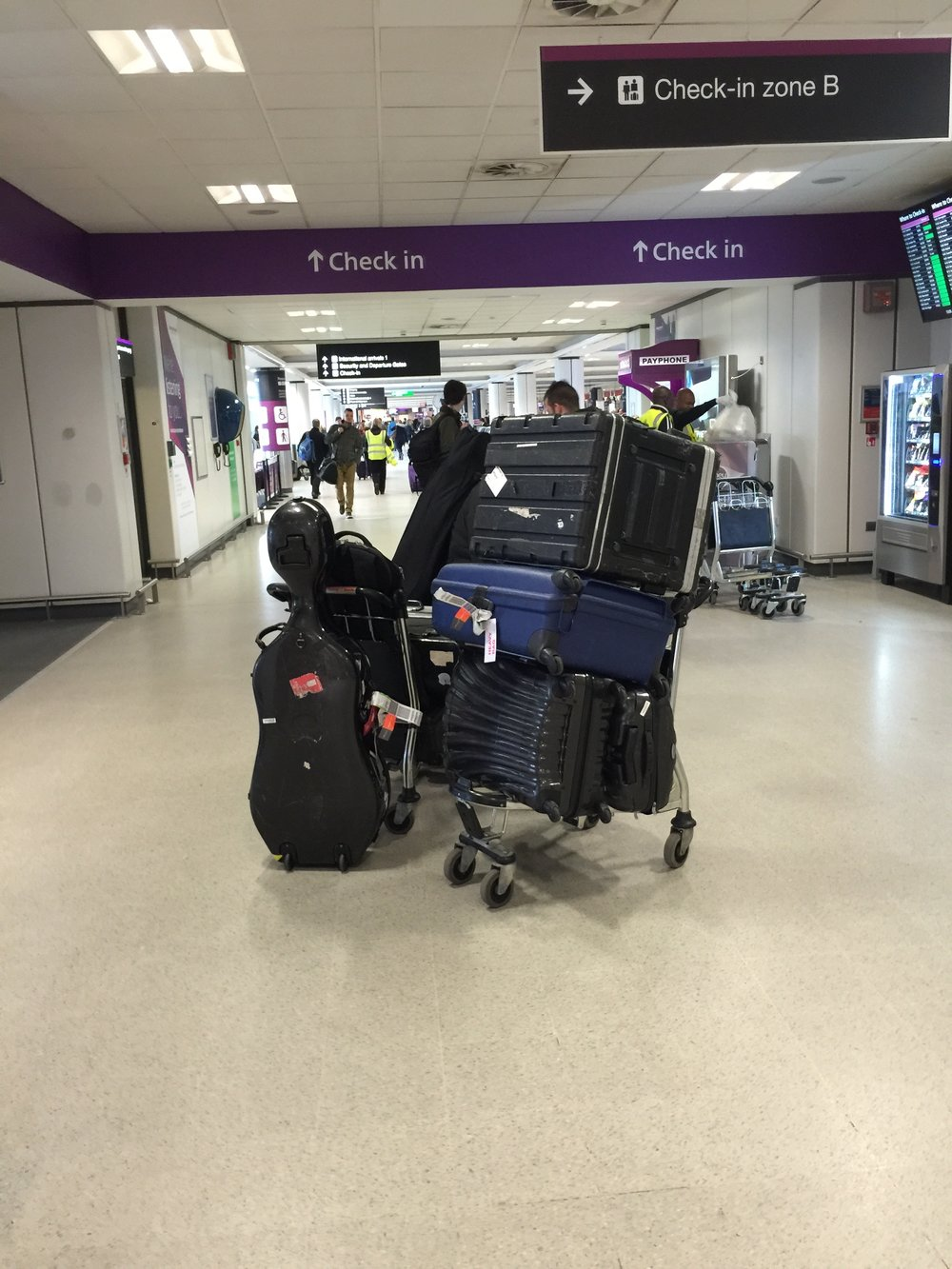 Stringfever electric quartet london airport luggage.jpg