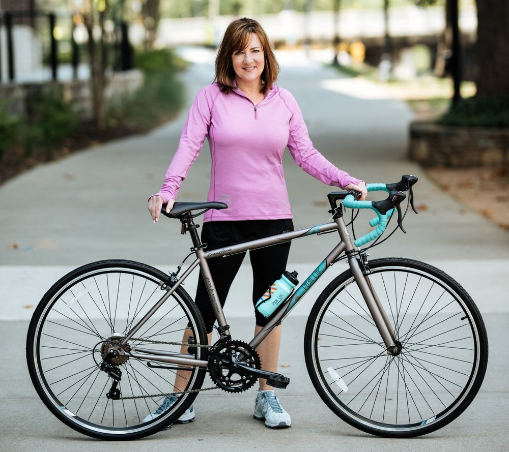 Owner Robin Bylenga shows off the Transform, one of her Pedal Chic-branded road bikes.