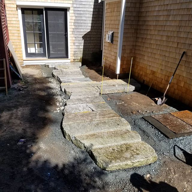 Reclaimed granite walkway coming along.  Awesome working with repurposed curb stock.  Takes some time to fine tune but it creates a one of kind install.  #reclaimed #granite #dgdesigninstall