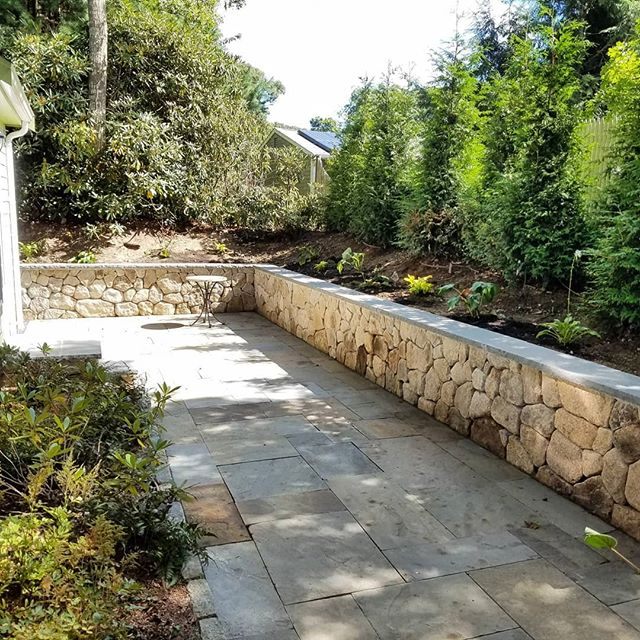 Series of before and after shots from our Lake Elizabeth project.  Natural cleft bluestone patio, native fieldstone retaining wall with dry tuck finish and rock faced bluestone cap.  Awesome collaboration with Mike Takach and his crew at Earth & Stone!  #dgdesigninstall #landscapedesign #capecod #landscapecontractor #travelswithjed