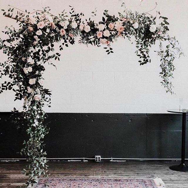A floating arbor of roses and greenery paired with an oriental rug makes for a romantic and ethereal ceremony spot image: @goodseedfloral . . . . . #denverwedding #denverweddingplanner #denverweddingplanning #coloradowedding #coloradoweddingplanner #coloradoweddingplanning #denvereventrentals #coloradoeventrentals #weddinginspiration #weddingdecor #coloradomountainweddings #coloradobride #rockymountainwedding #boulderwedding #wedcolorado #weddingrentals #modernbohowedding #denvervenue #engaged #coolbride #ido #modernbride