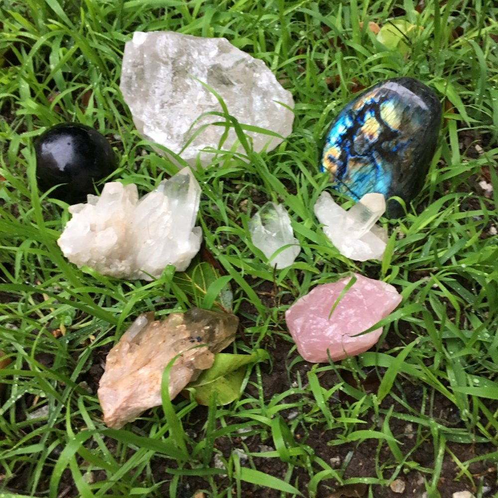 Quartz clusters, labradorite, rose quartz, smoky quartz, and clear quartz getting a nice rainwater bath and re-connecting with the Earth. Rain is perfect for most stones, but NEVER put selenite in the rain because it will dissolve!