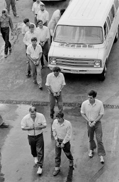 George Malvaney (center front) and the other nine mercenaries involved with the Bayou of Pigs plot entering the Orleans Parish Prison, April 1981. AP Photo/Jack Thornell.