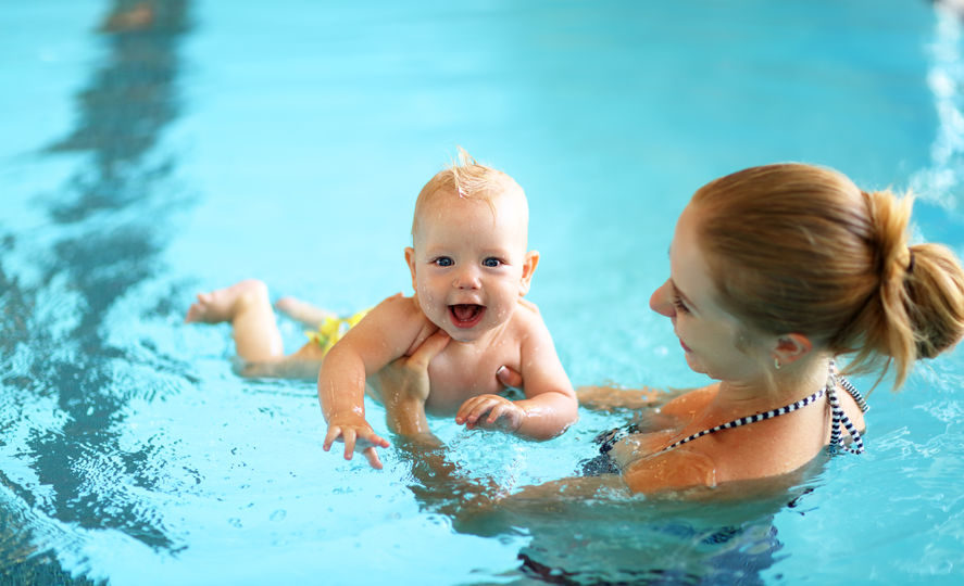 baby-swimming-with-woman.jpg